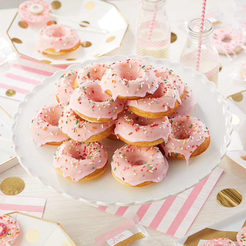Party in Pink Donut Cake - Pink iced donuts, stacked on a cake pedestal with rainbow sprinkles image number 0