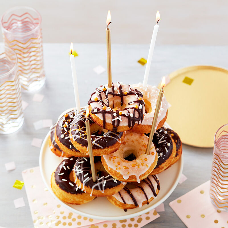 All the Glitters is Gold Donut Cake - Stacked donut cake with vanilla and chocolate glaze and gold candles image number 1