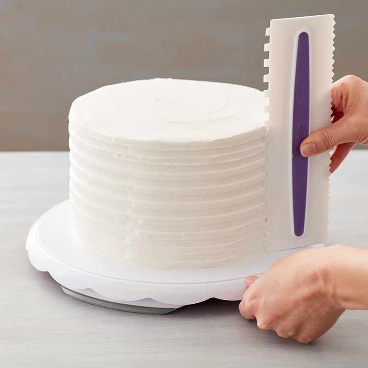 buttercream frosting being spread on cake