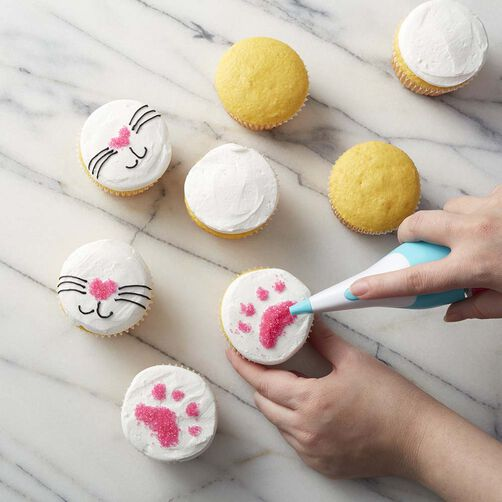 Yellow cupcakes with pink sugar paw prints and cat faces