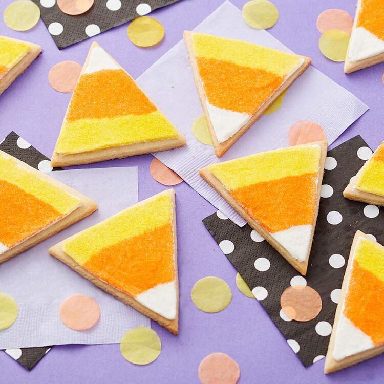 Candy corn cookies using yellow, orange, and white sugars to create stripes