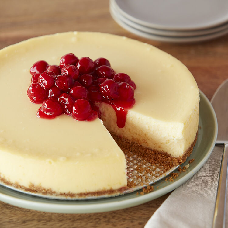 Creamy Cheesecake topped with Cherries