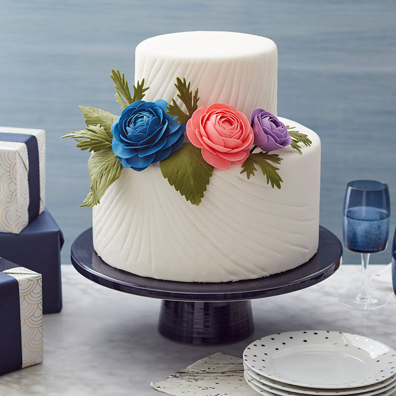 White, two-tiered cake with two large gum paste roses image number 0
