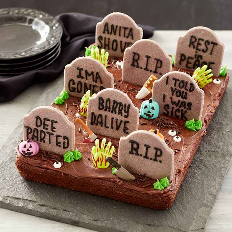 graveyard brownie cake topped with pumpkins, tombstones and halloween icing decals