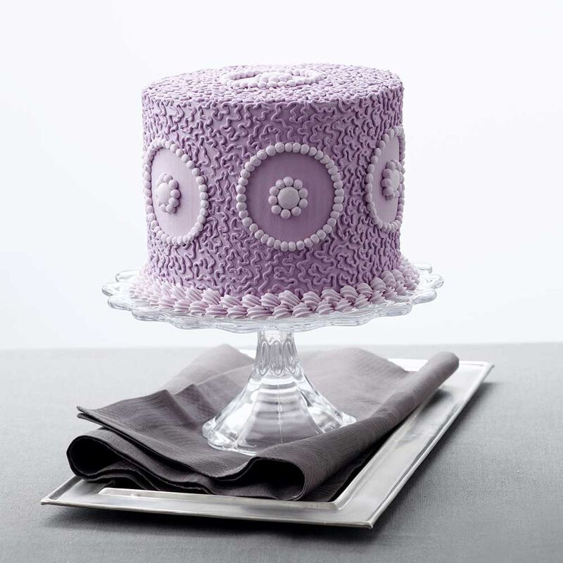 Purple round cake with purple piped cornelli lace image number 2