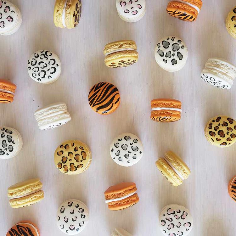 macarons decorated with tiger stripes and grey, pink and white leopard animal print