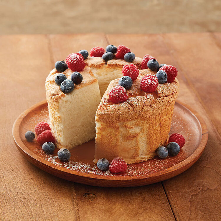 Mini angel food cake topped with a variety of berries