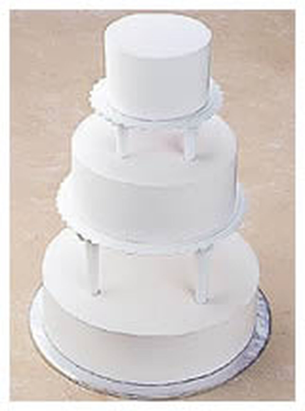 making a two tiered wedding cake push in tiered cake construction wilton 17042