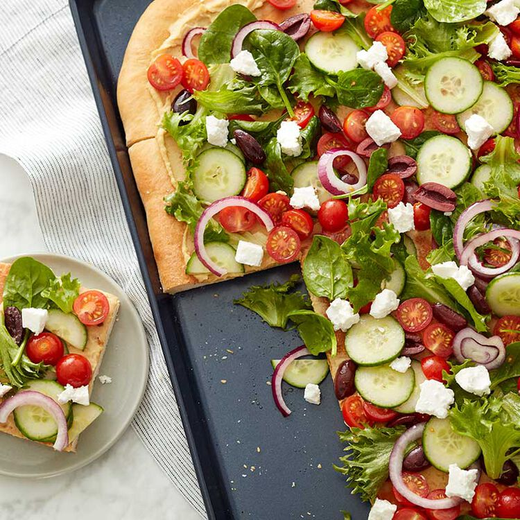 Flatbread pizza on a large baking sheet
