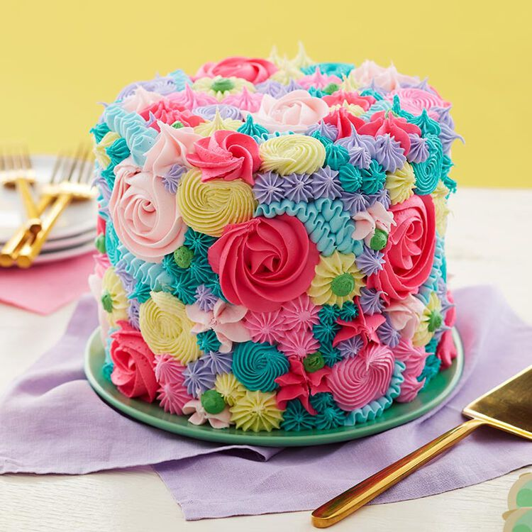 Colorful cake piped with spring floral using buttercream frosting