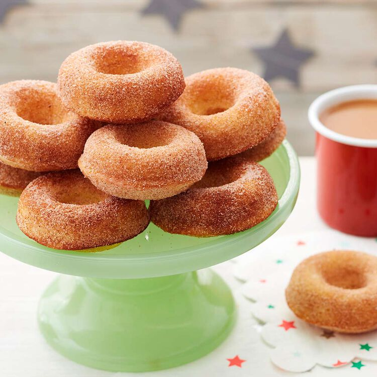 Cinnamon sugar donuts on a treat stand