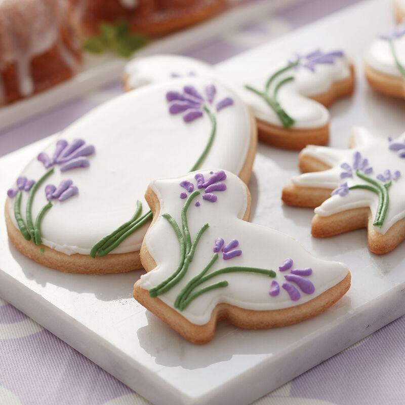 Blooming Easter Cookies, white royal icing with lavender flowers on top image number 1