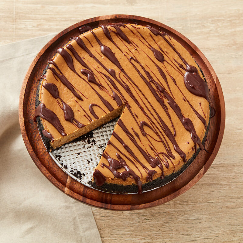 Mocha Cheesecake with chocolate drizzle, view from the top image number 0