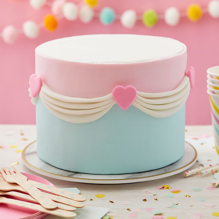 Round cake decorated with ruched fondant and hearts