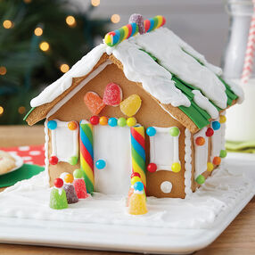 Gingerbread House Decorating Ideas & Designs | Wilton on marzipan icing, stick pretzels with white icing, gingerbread on houses, lemon glaze icing, cake icing, biscuit icing, birthday icing, basket icing, french vanilla icing,