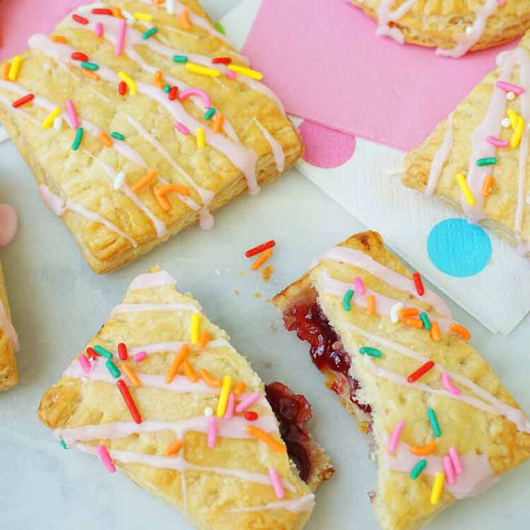 raspberry filled breakfast pies topped with frosting and sprinkles