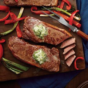 Broiled Strip Steaks with Garlic & Herb Butter