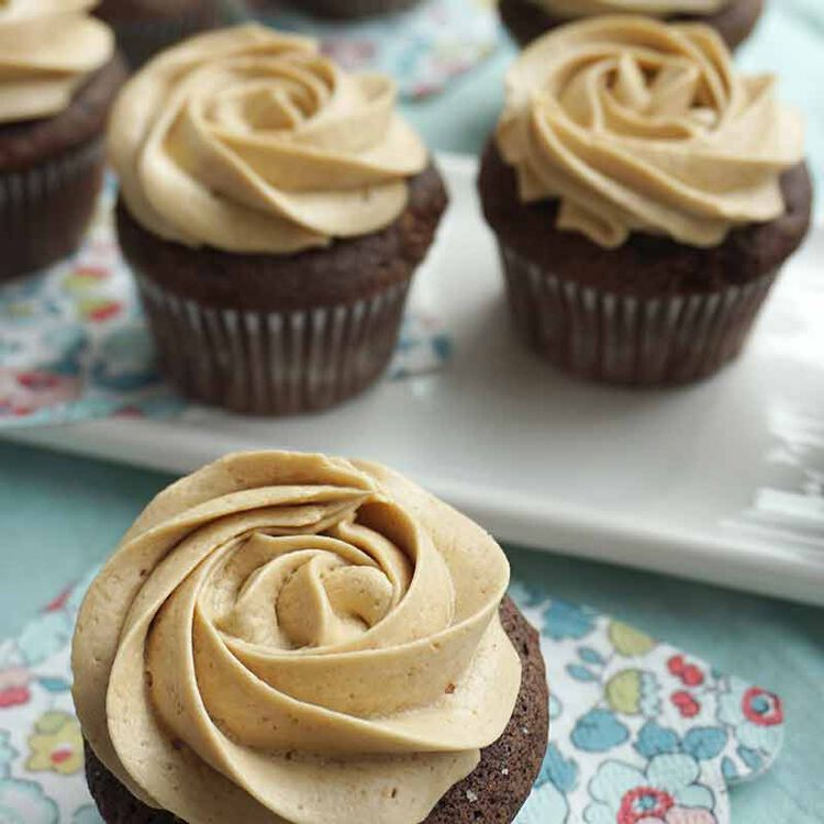 chocolate cupcakes decorated with brown sugar buttercream frosting