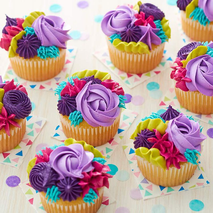 Textured Buttercream piped cupcakes in purples, pinks, and green.