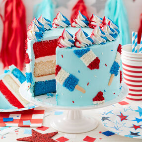 Red, White and Blue Ice Pop Cake, cut cake.  Cake layers red, white, and blue with red, white, and blue popsicles piped on the cake and swirls on top