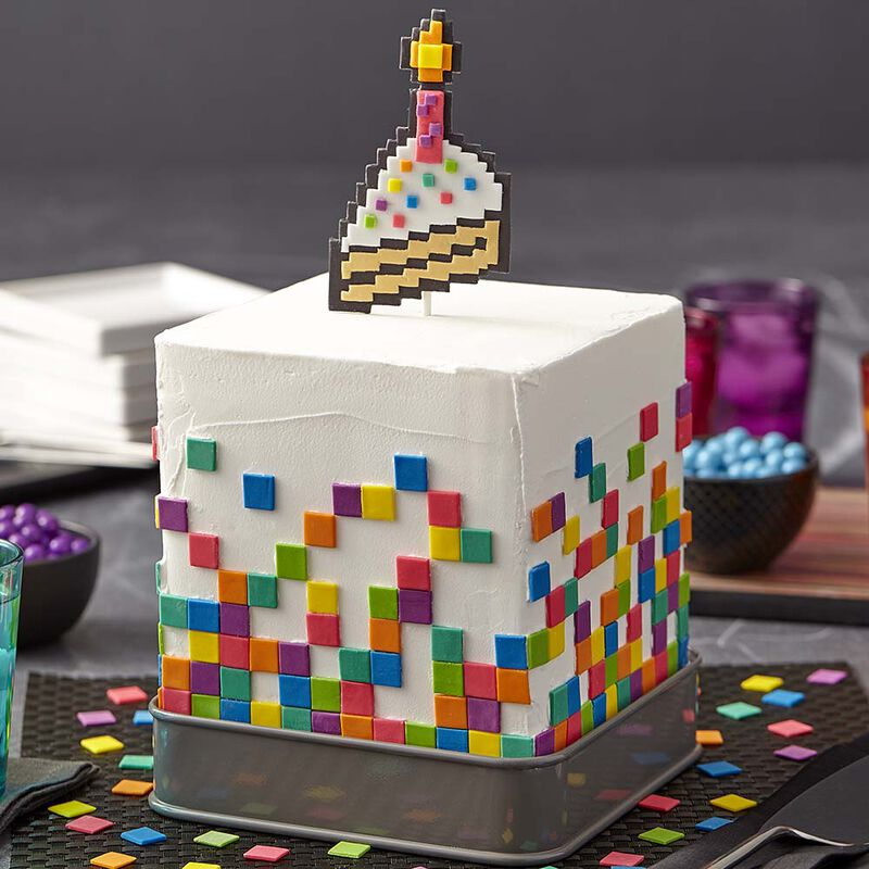 White cubed cake with fondant rainbow pixels and pixelated cake topper image number 0