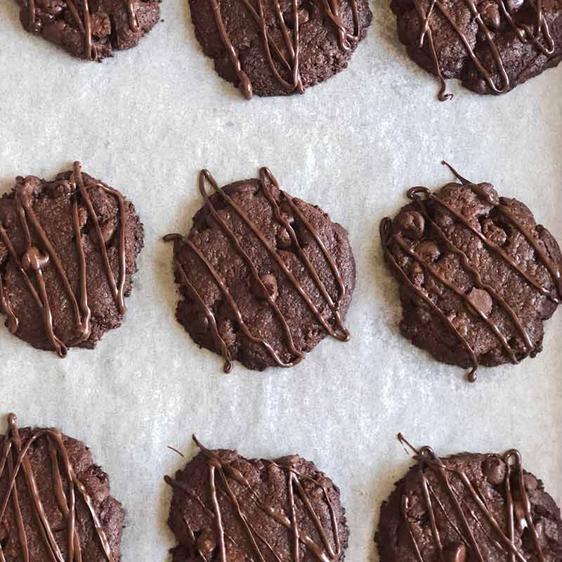 chocolate brownie cookies on parchment paper image number 2