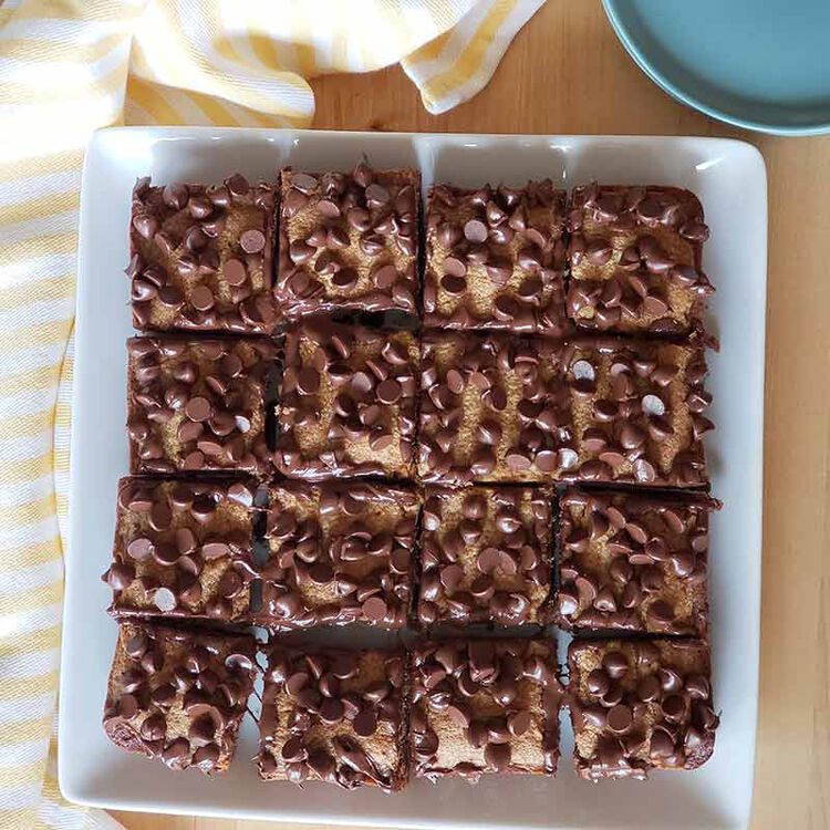 peanut butter brownies on plate cut into pieces