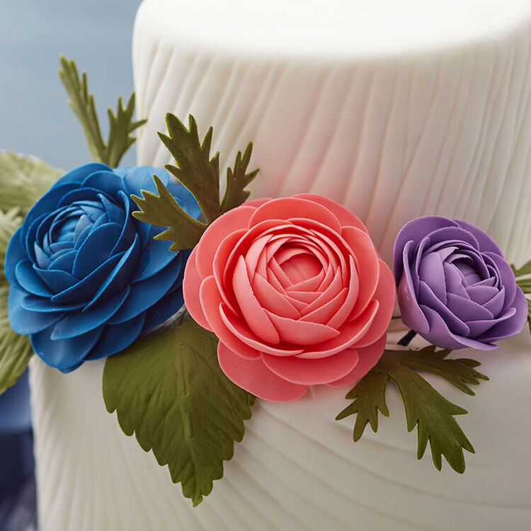 White, two-tiered cake with two large gum paste roses