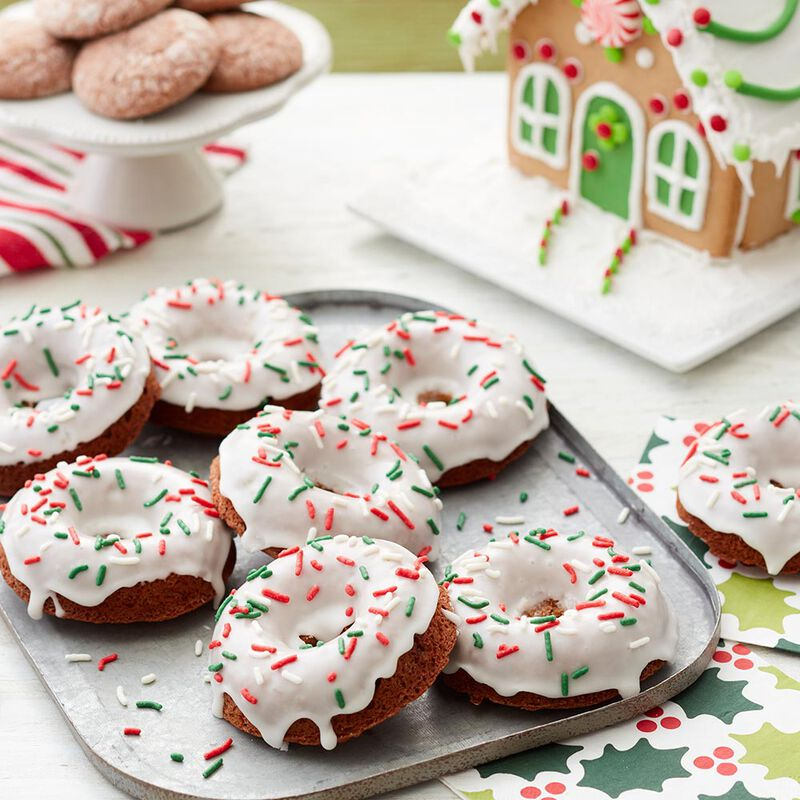 festive gingerbread donuts with white icing and red and green sprinkles  image number 0