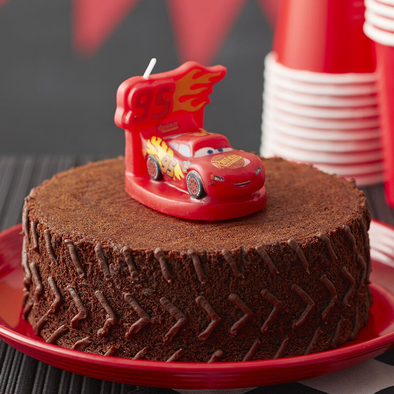 Cars 3 Brownie Tire Cake featuring a Lightning McQueen candle image number 0