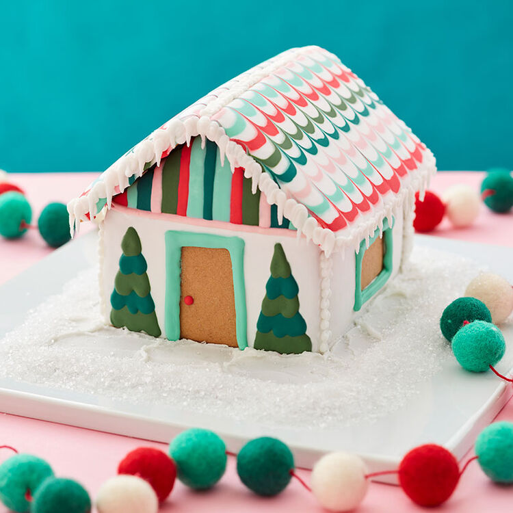 Small gingerbread house decorated using Wilton cookie icing.