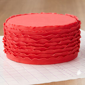 Red Ruffled Ribbons Fondant Cake