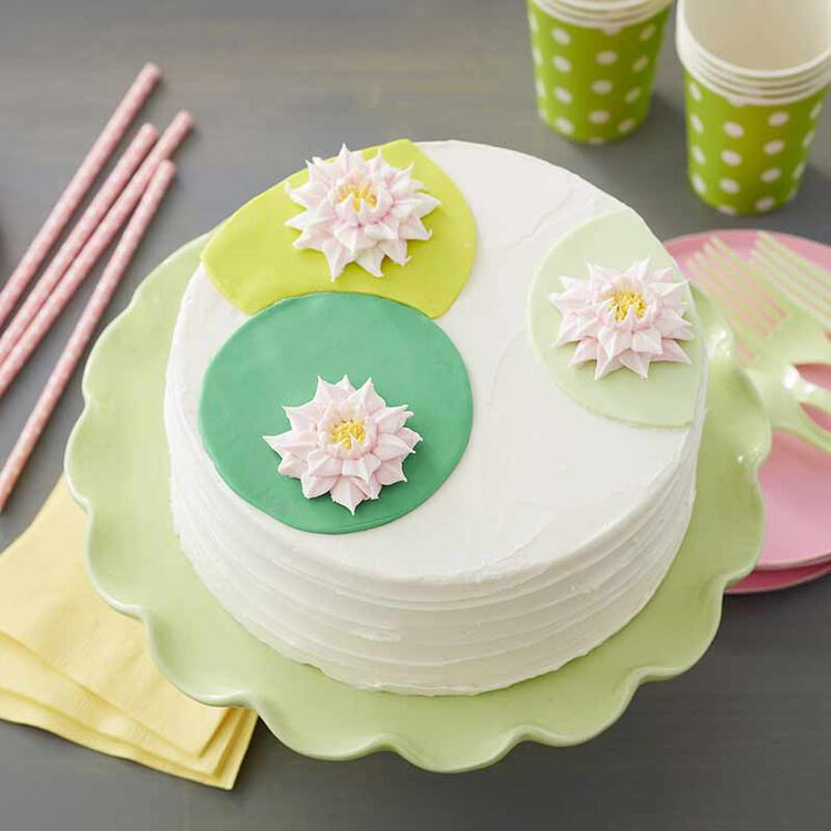 buttercream cake decorated with buttercream water lilies