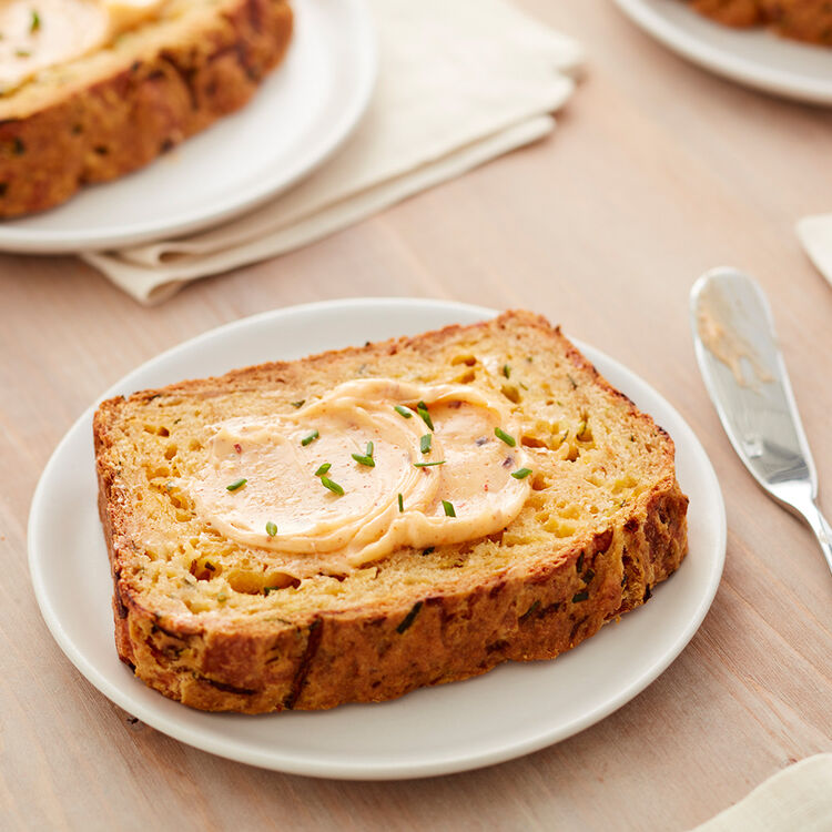 Slice of Zucchini Cheddar Bread with Spicy Honey Butter