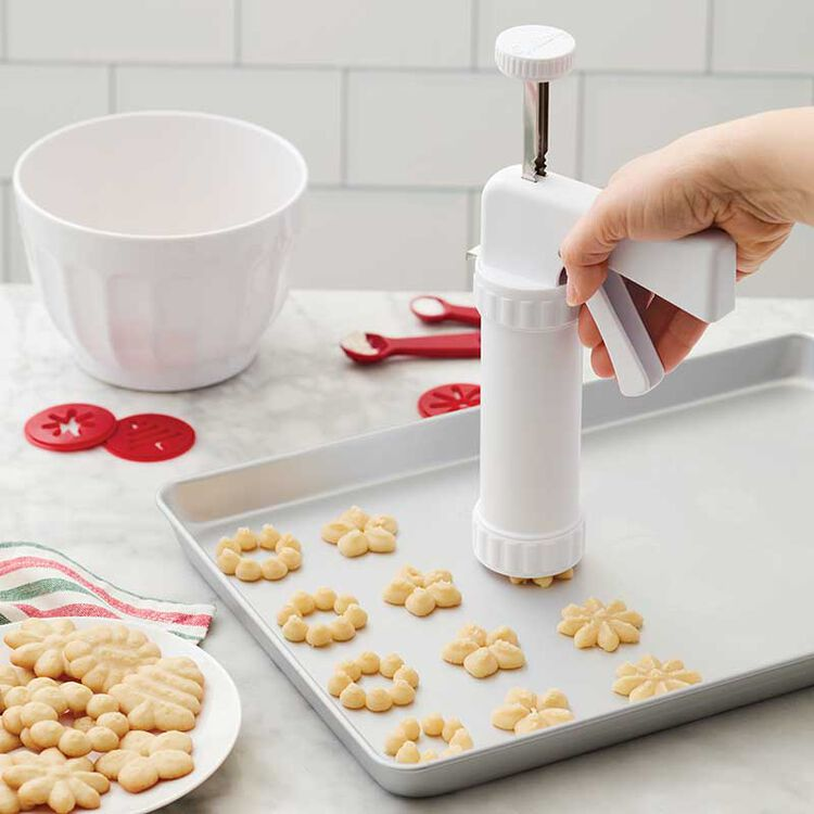 Piping Spritz Cookies with a Cookie Press