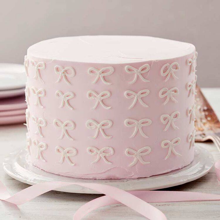 pink buttercream bow cake