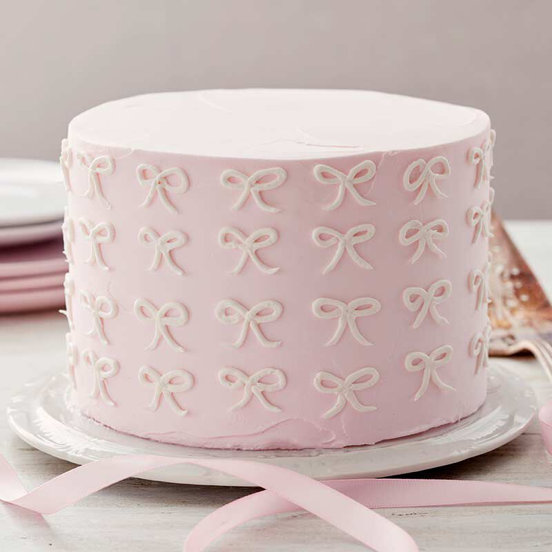 pink buttercream bow cake image number 0