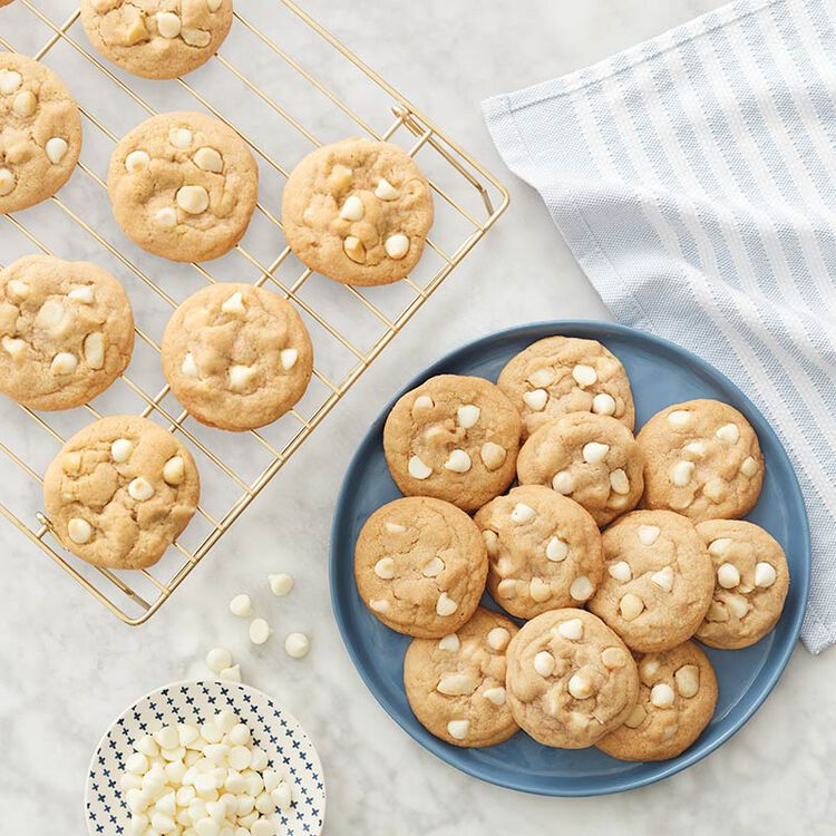 White Chocolate Macadamia Nut Cookies on a gold cooling rack