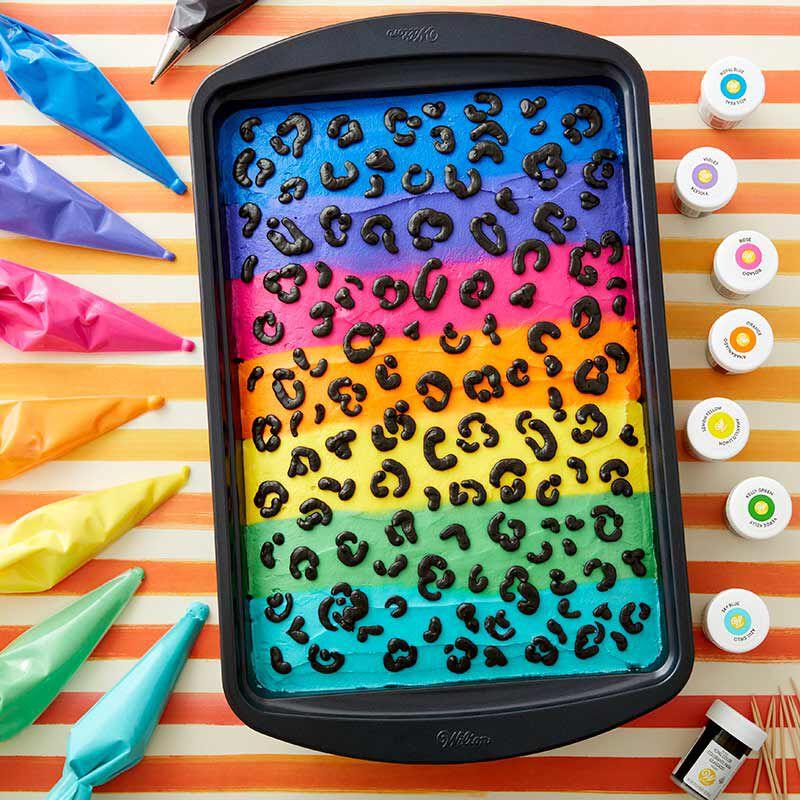Rectangular sheet cake decorated in neon colored buttercream, with animal print spots image number 0