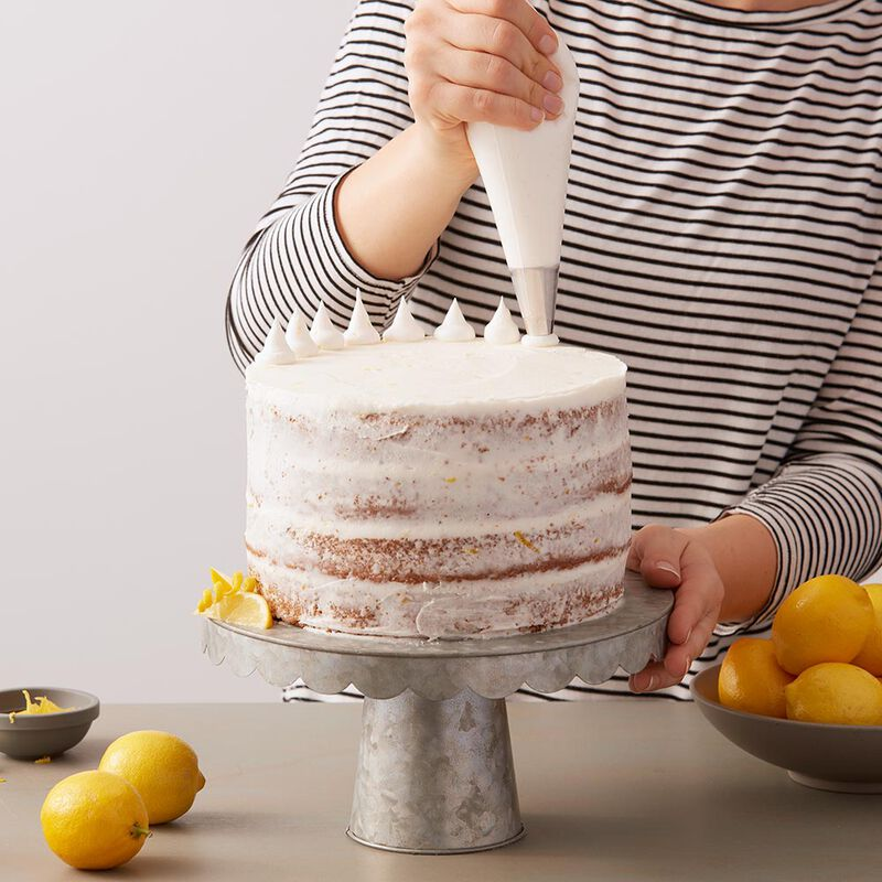 Naked cake with white lemon buttercream frosting image number 0