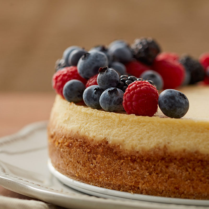 Classic cheesecake topped with fresh berries image number 1