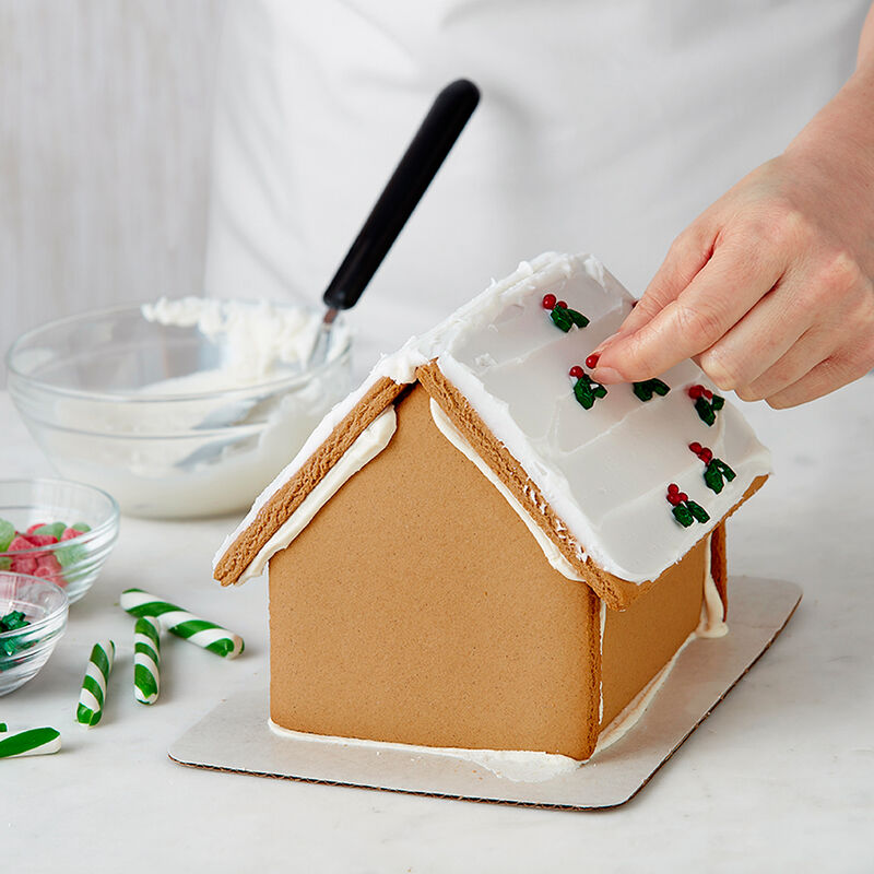 How to Attach Candy to a Gingerbread House image number 2