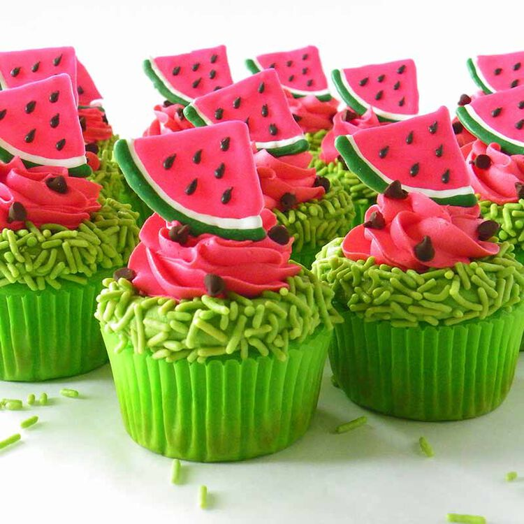 cupcakes topped with green sprinkles and watermelon cupcake toppers made of candy melts candy