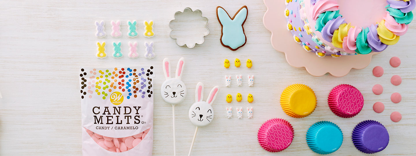 Easter products- baking cups, flower cookie cutter, chick and bunny icing decorations.