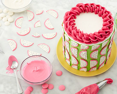 Dragon fruit slices made from Candy Melts used to decorate a green cake