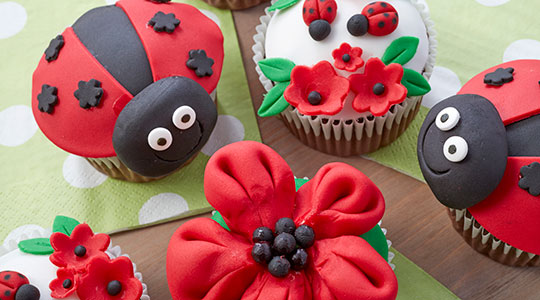 Red and black ladybug cupcakes