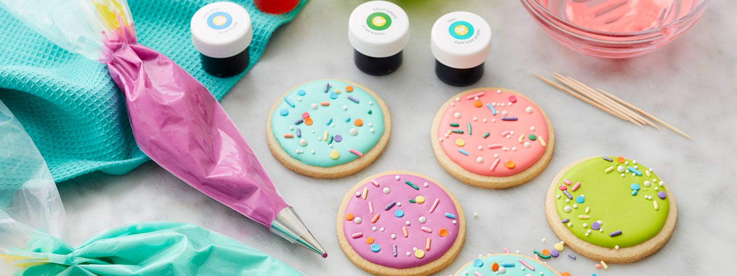 Round cookies topped with royal icing and colored with Wilton food coloring
