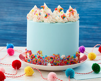 Blue cake with rainbow arch sprinkles