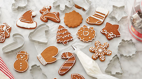 Christmas metal cookie cutters and decorated shaped cookies