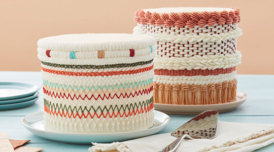 Cakes with piped buttercream that looks like woven yarn